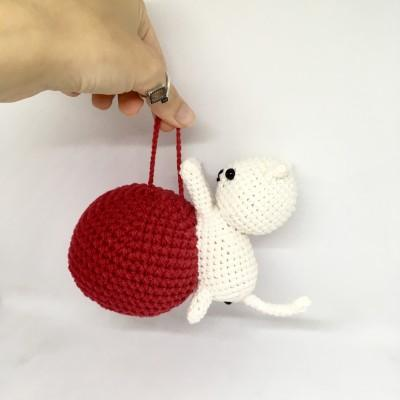 Amigurumi cat on the Christmas ball