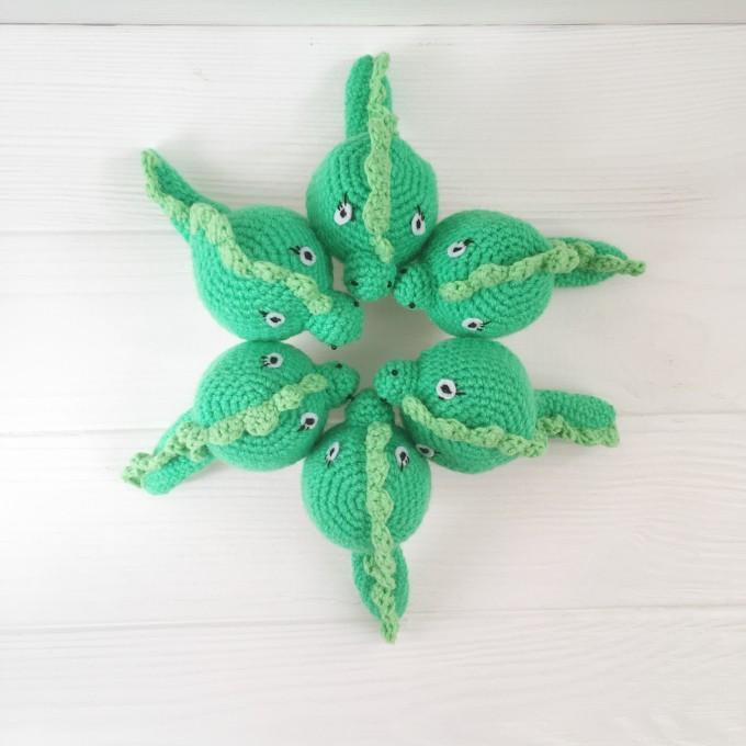 Set of crochet green dragons