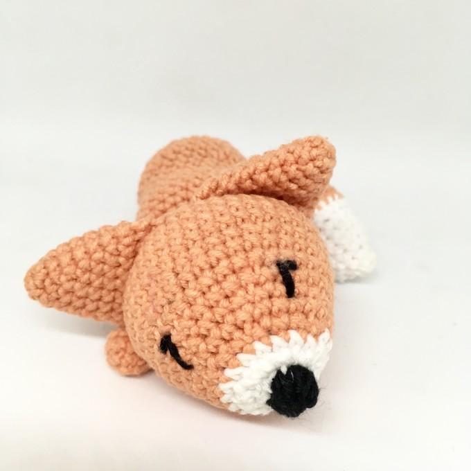 Amigurumi sleeping red fox